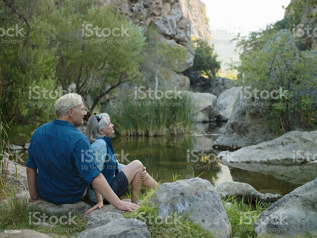Mature couple sitting next to a canyon royalty-free stock photo