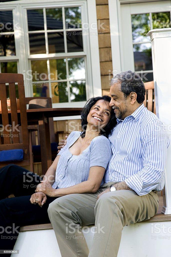 Mature couple sitting on back porch royaltyfri bildbanksbilder