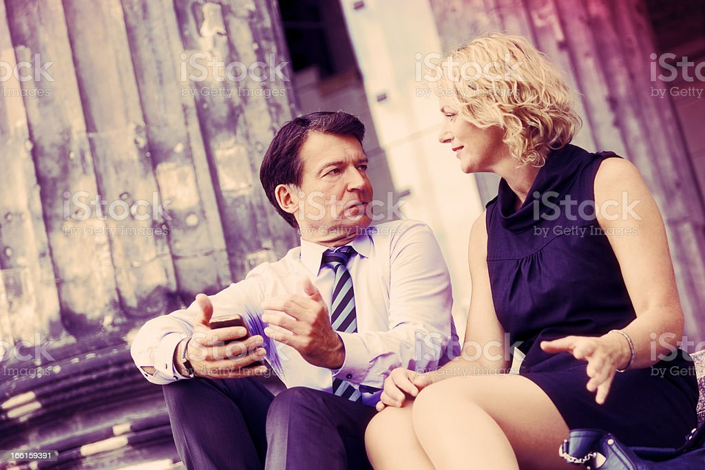 Mature Couple Sitting with Smart Phone Cross-Processed (Xpro) royalty-free stock photo