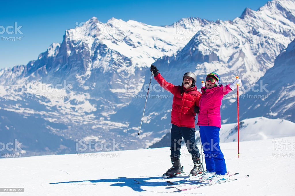 Mature couple skiing in the Alps mountains – Foto