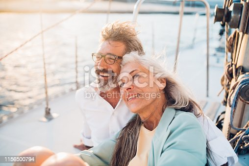 Senior couple in love sailing together