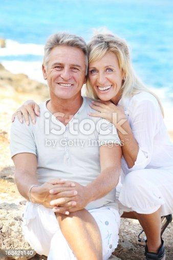 119998253istockphoto Mature couple smiling 168421140