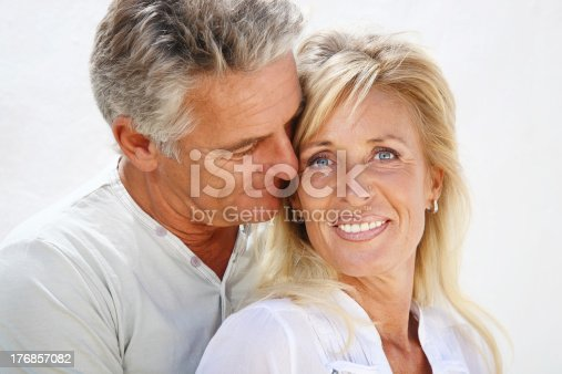 119998253 istock photo Mature couple smiling 176857082