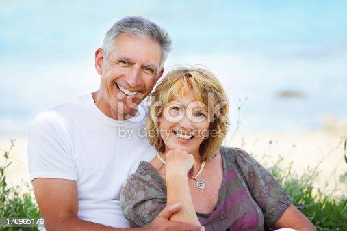 119998253 istock photo Mature couple smiling 176965176
