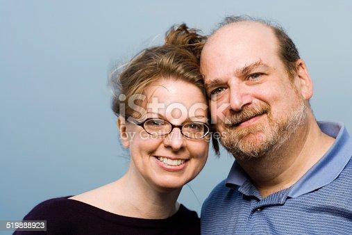 istock Mature couple smiling, portrait, close-up 519888923