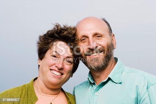 istock Mature couple smiling, portrait, close-up 519888927