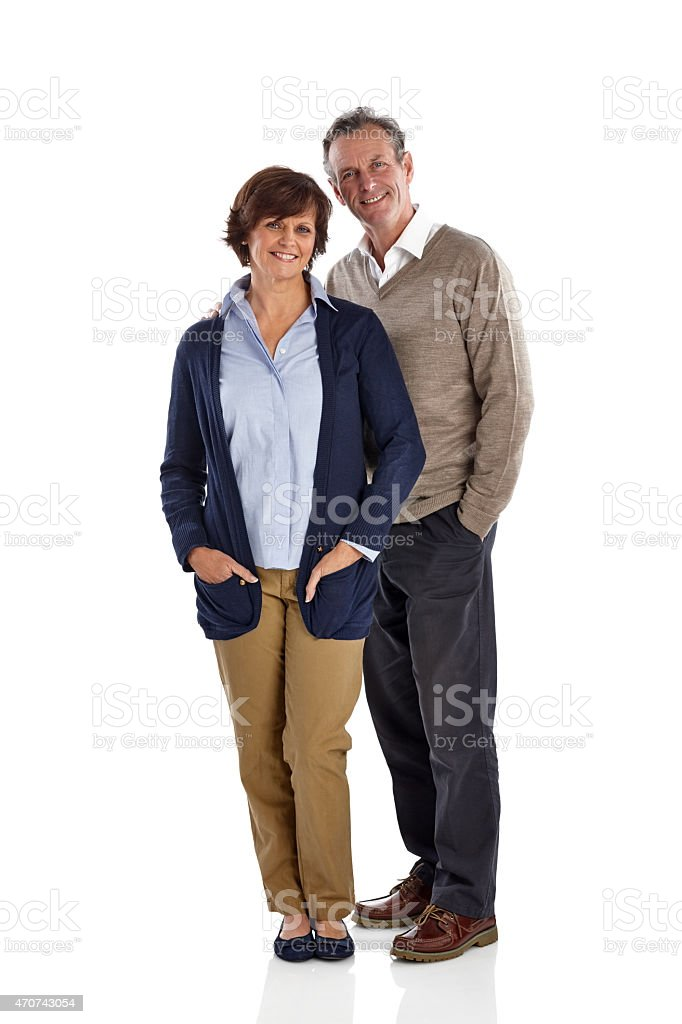 Mature couple standing together in studio stock photo