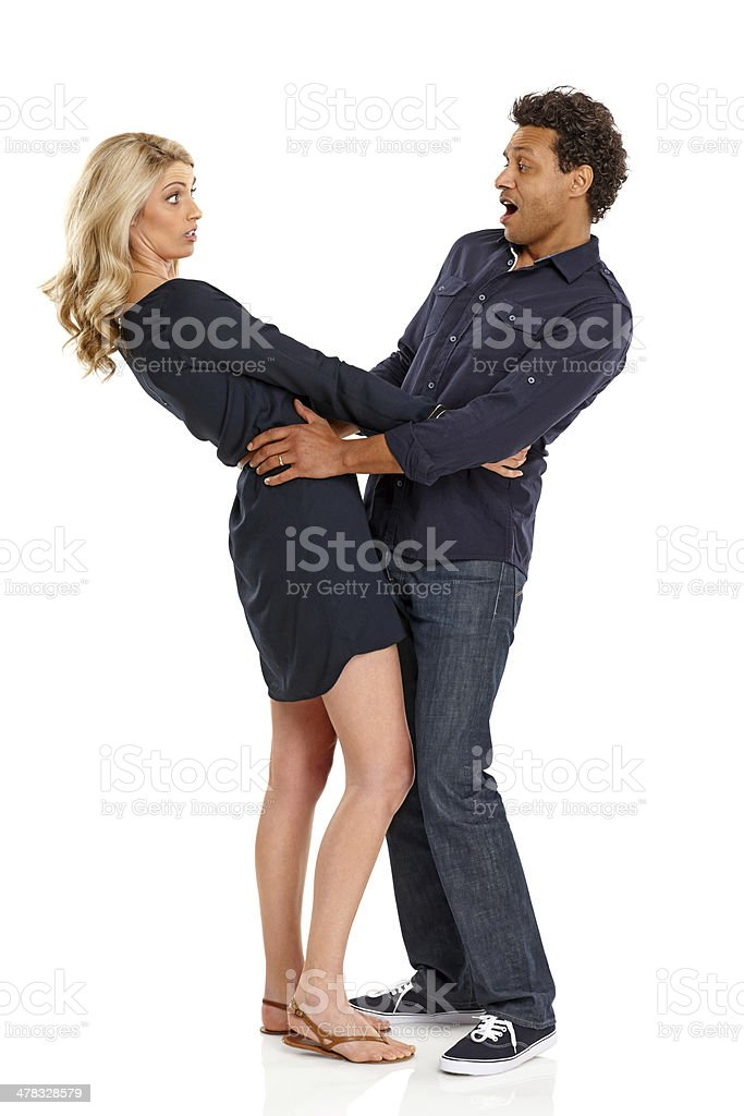 Mature couple standing together looking surprised royalty-free stock photo