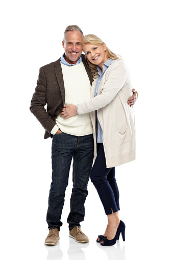Full length portrait of mature couple standing together on white background
