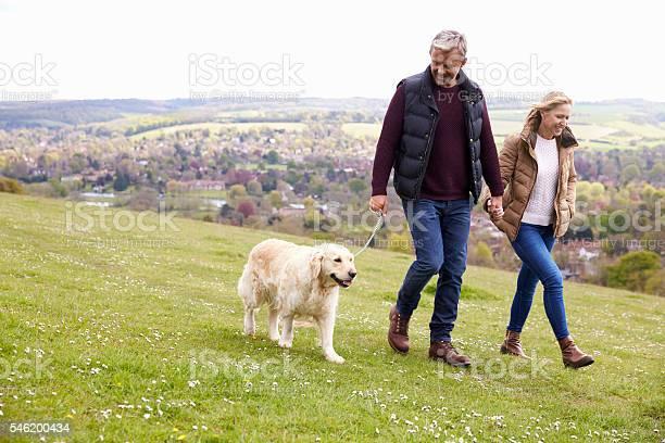 Mature couple taking golden retriever for walk picture id546200434?b=1&k=6&m=546200434&s=612x612&h=0dujnp2xjsznxkiapqopkqww52aabu89bkfkbxm6ddm=