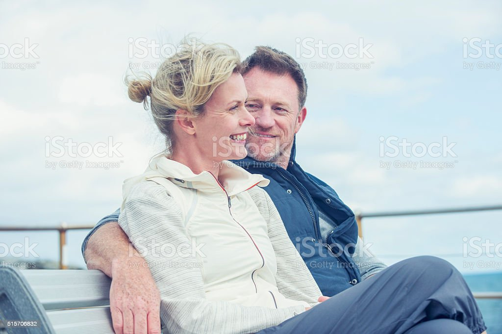 Mature couple talking and flirting. stock photo