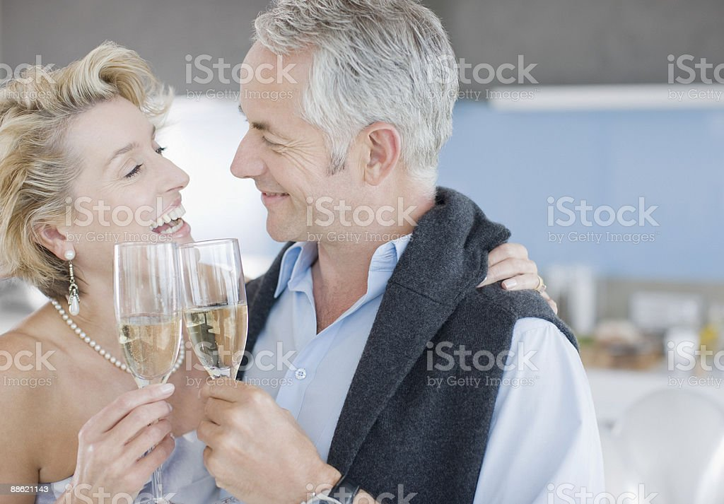 Mature couple toasting with champagne royalty-free stock photo