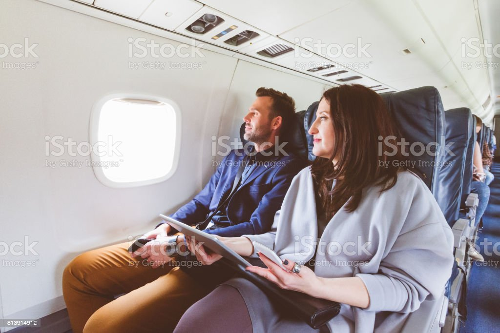 Mature couple traveling by airplane stock photo