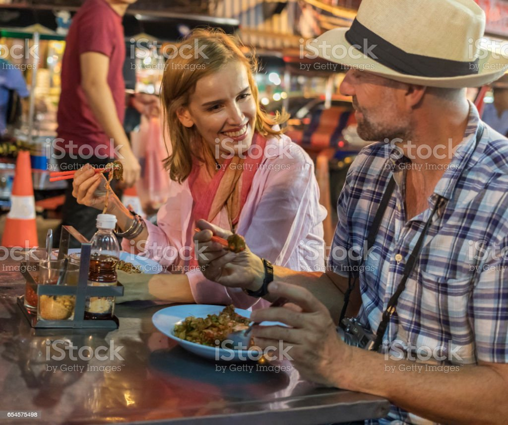 Mature Couple Trying Thai Street Food in Bangkok stock photo