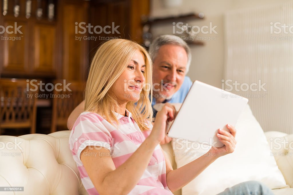 Mature couple using a digital tablet stock photo