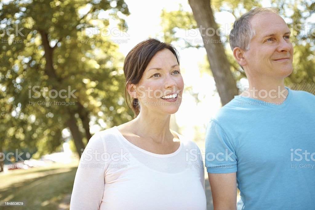 Mature couple walking in the park royalty-free stock photo