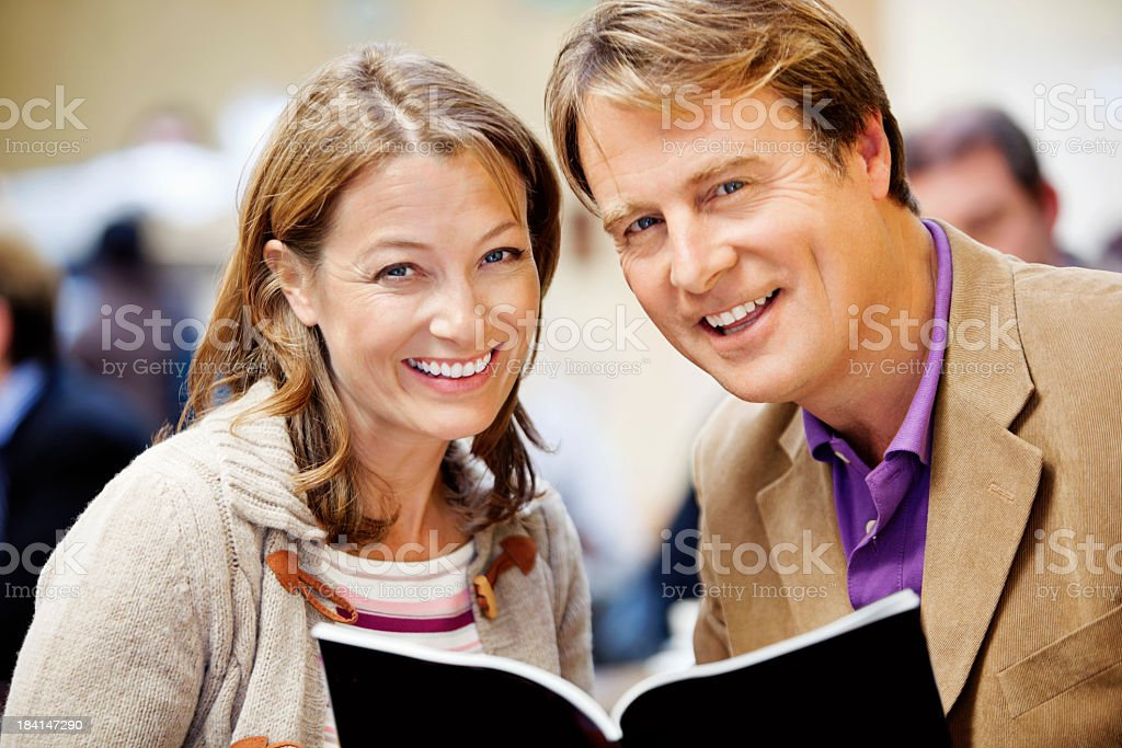 mature couple with brochure royalty-free stock photo