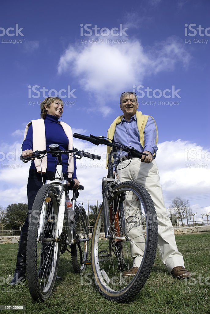 Mature couple with bycycles royalty-free stock photo