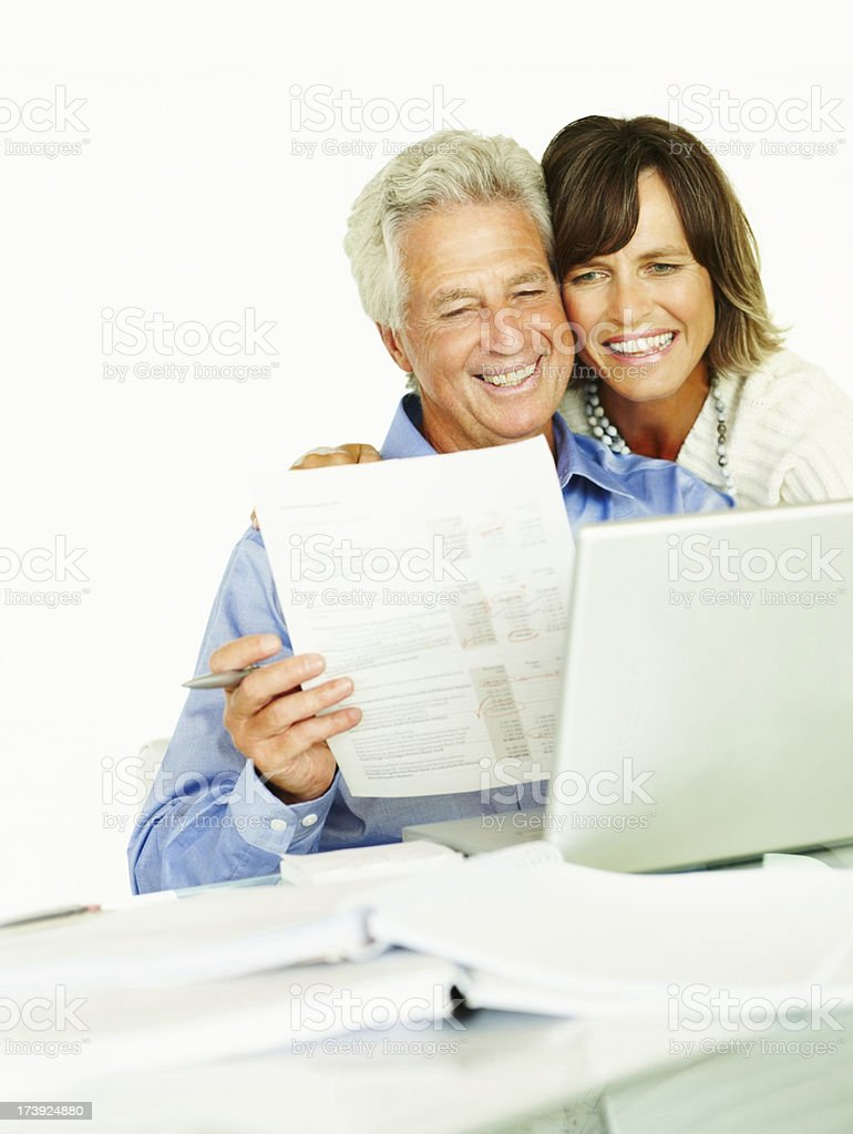 Mature couple with documents and laptop royalty-free stock photo