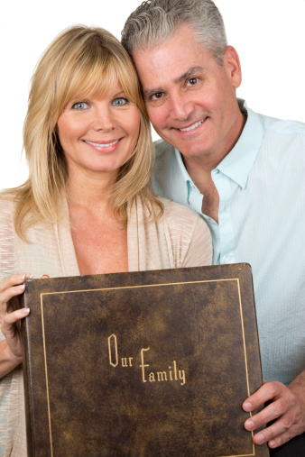 Mature Couple With Family Album Stock Photo - Download -1076