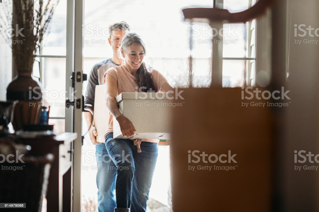 Mature Couple with Moving Boxes in New Home stock photo