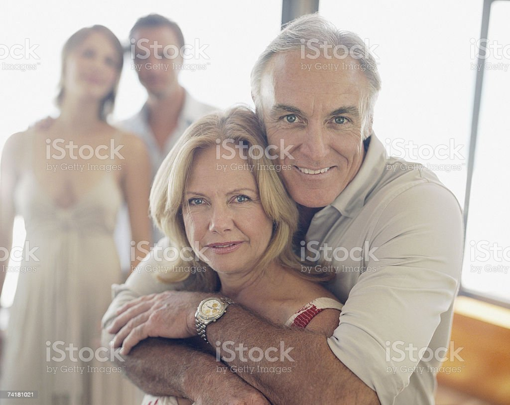 Mature couple with younger couple in background royalty-free stock photo