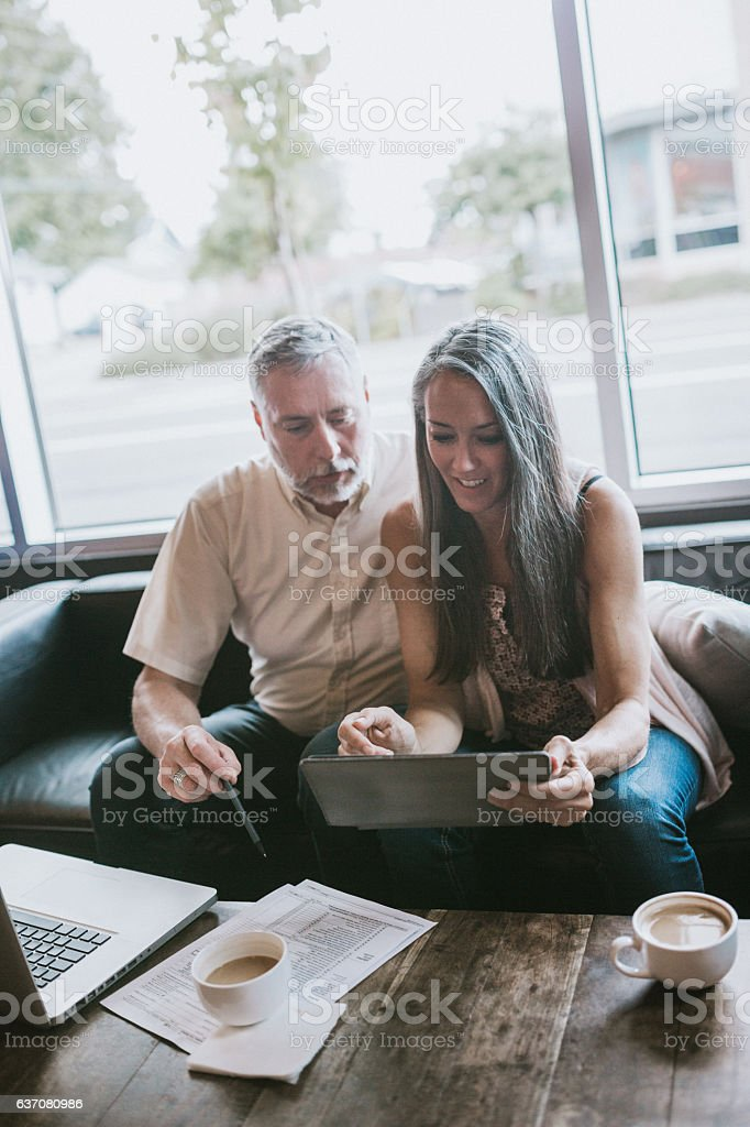 Mature Couple Working on Taxes stock photo