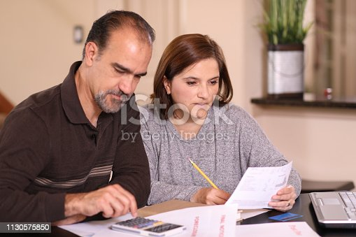 istock Mature couple working out family finances together at home. 1130575850