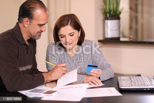 istock Mature couple working out family finances together at home. 1130575894