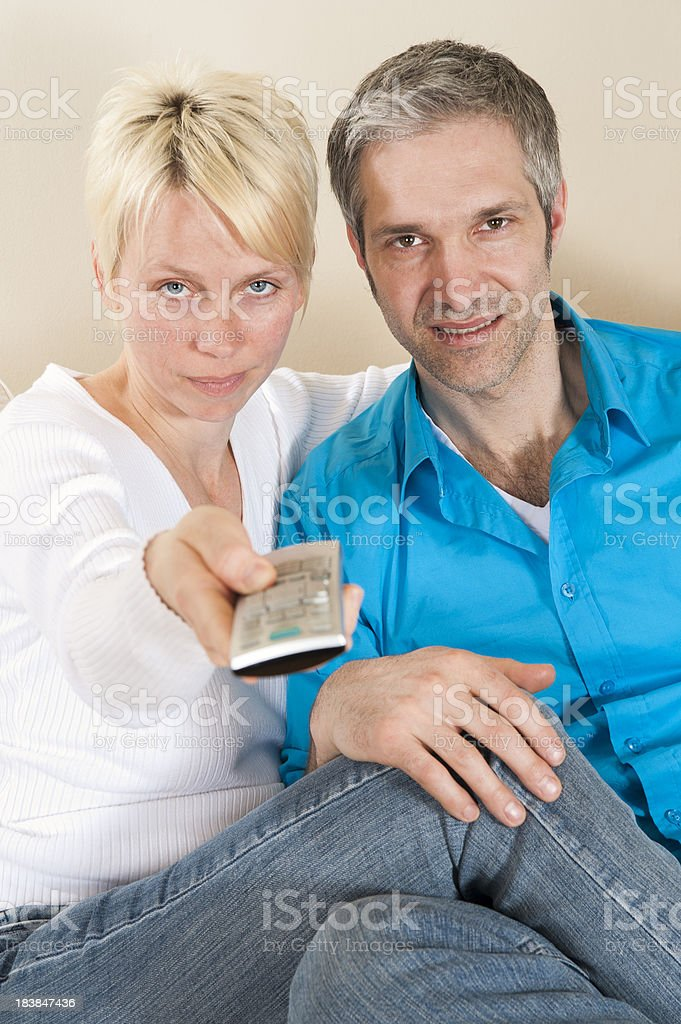 Mature couple zapping with remote control. royalty-free stock photo