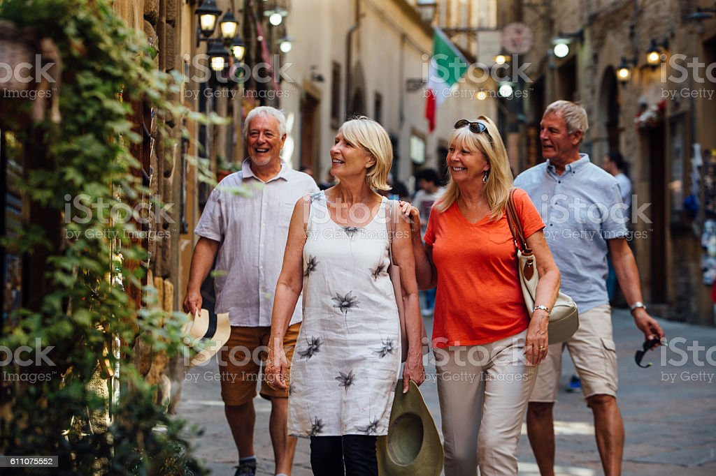 Mature Couples Looking Around Old Town Italy - foto de acervo