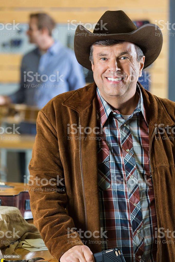 Mature Cowboy In Guitar Repair Shop Stock Photo & More