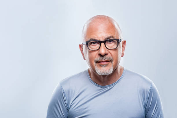 Mature Creative  Type Early sixties creative type male with glasses and goatee. 60 64 years stock pictures, royalty-free photos & images