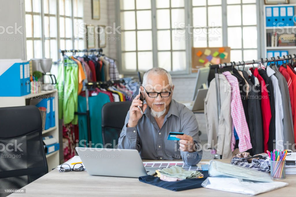 Mature Designer In Fashion Studio Using Credit Card Stock Photo Download Image Now Istock