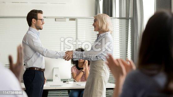 istock Mature director holding hands of best employee express praising gratitude 1147384846