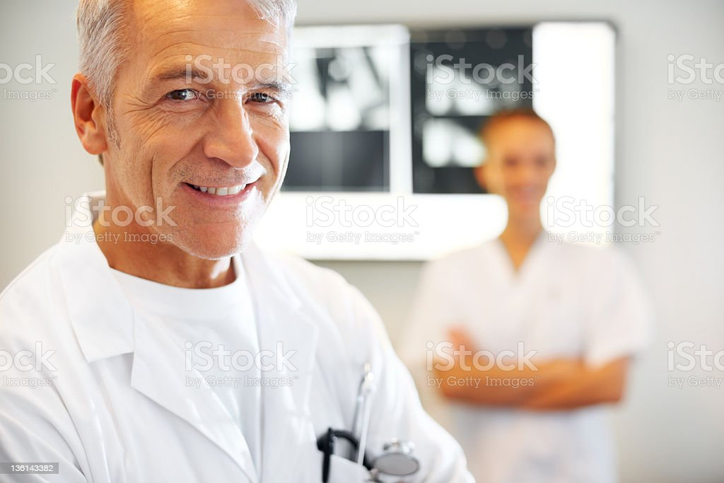 Mature doctor and his assistant royalty-free stock photo
