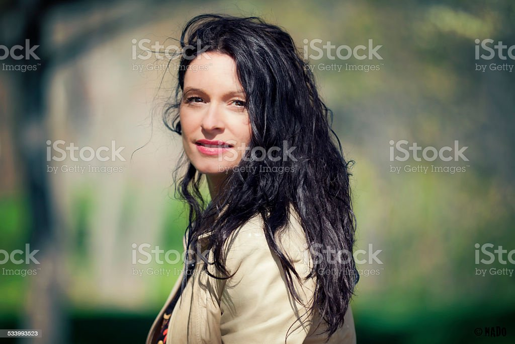 Mature Ethnic Woman Looking At The Camera stock photo