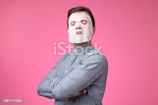 istock Mature european man in a cosmetic mask for skin care 1091711032