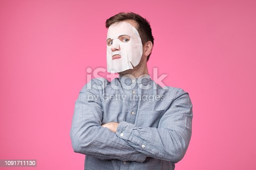 istock Mature european man in a cosmetic mask for skin care 1091711130