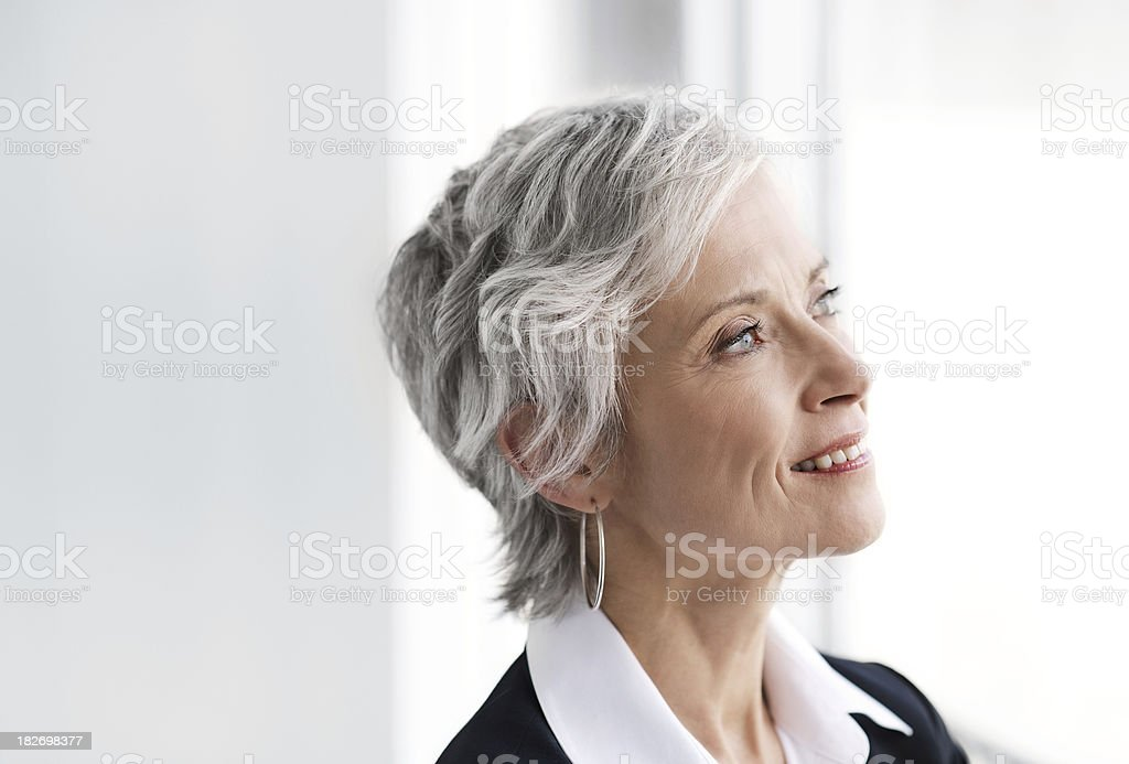 Mature executive business woman looking to the future royalty-free stock photo