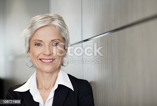 istock Mature executive business woman smiling 109721958
