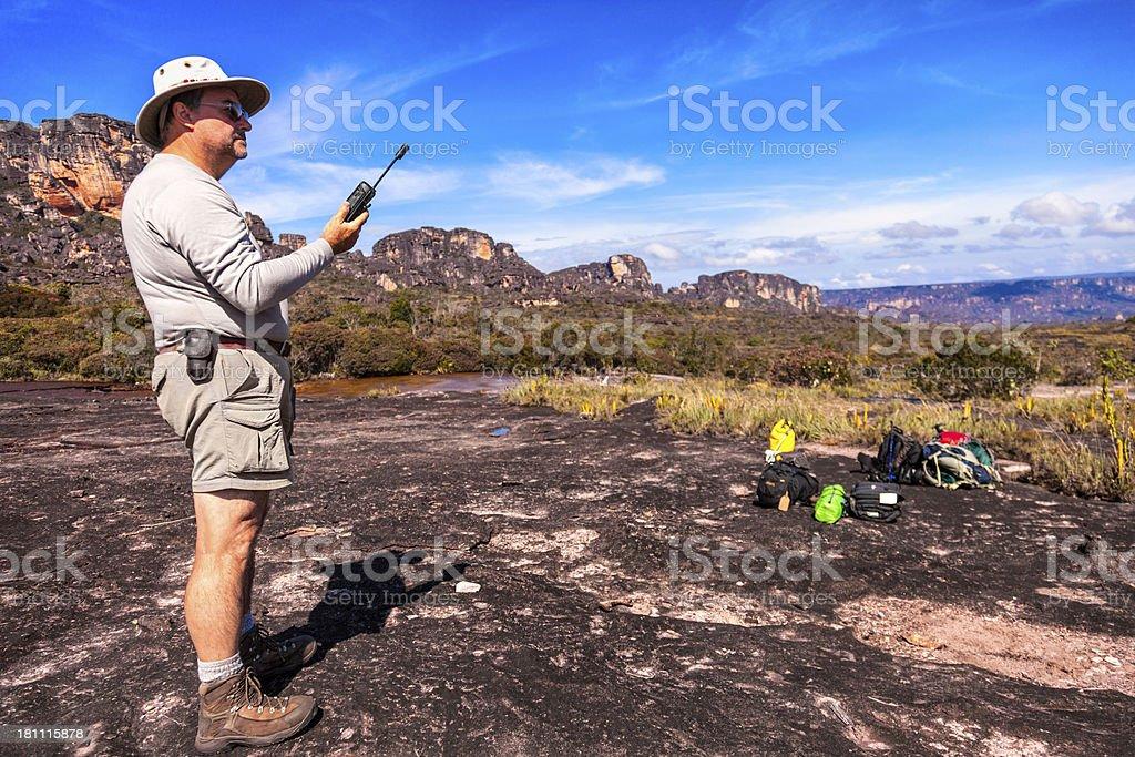 Mature explorer talking on satellite portable phone stock photo