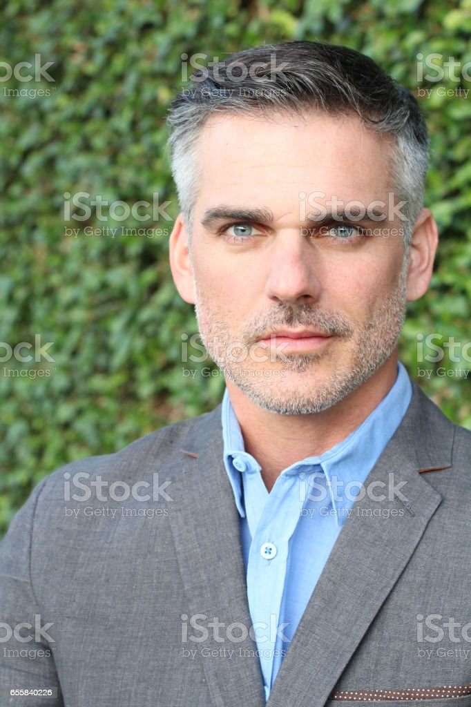 Mature extremely attractive man isolated stock photo