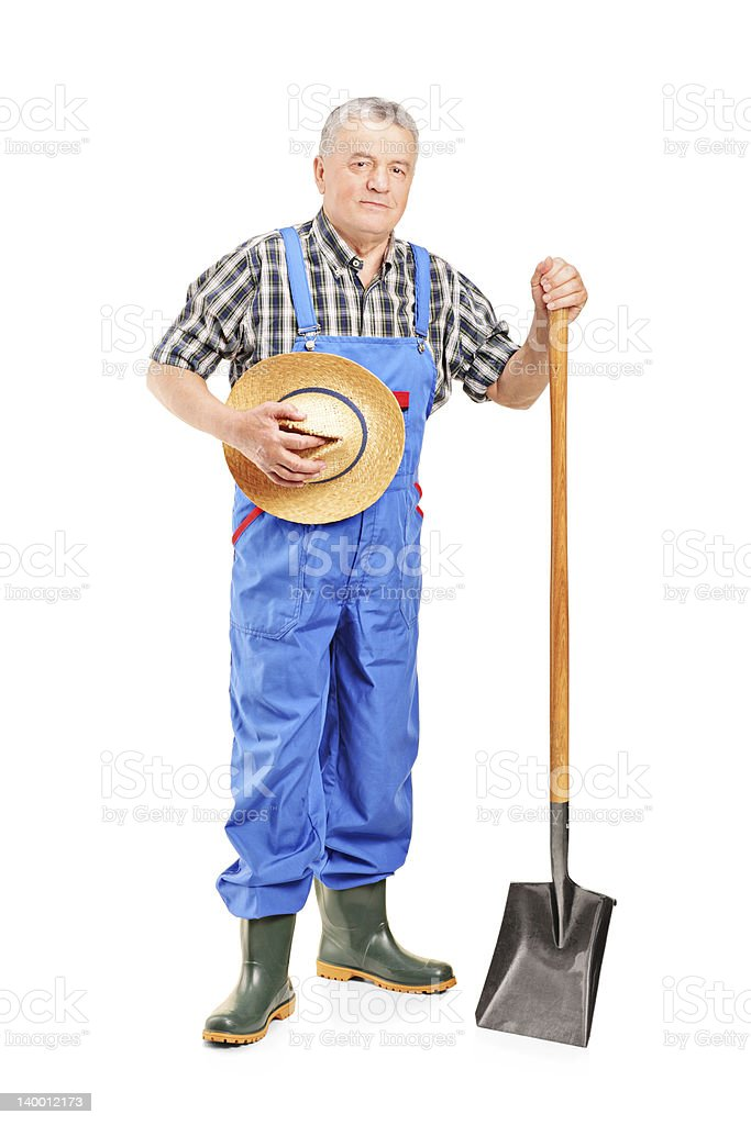 Mature farmer holding a shovel royalty-free stock photo