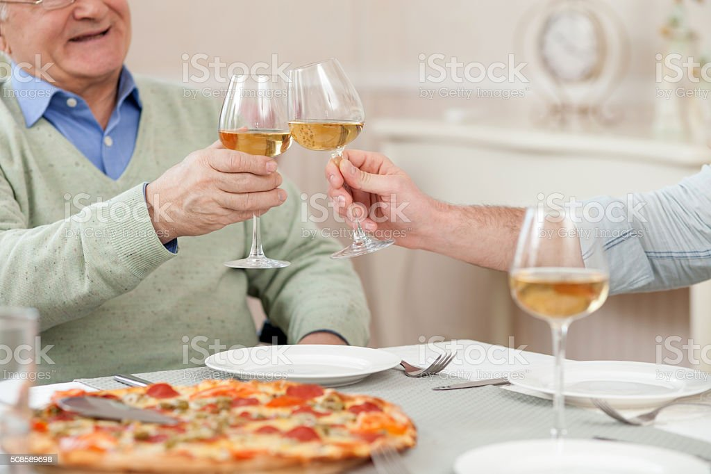 Mature father and his son in cafe stock photo