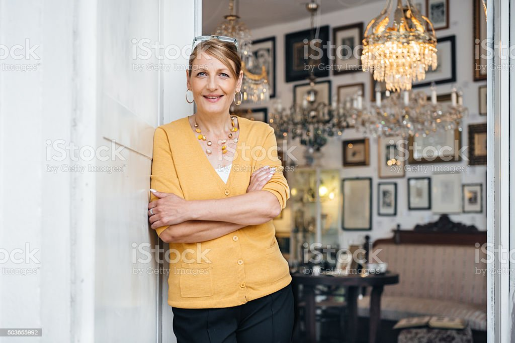 Mature Female Antique Store Owner stock photo