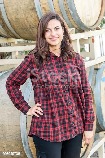 istock Mature female business owner posing at her small winery 998059708