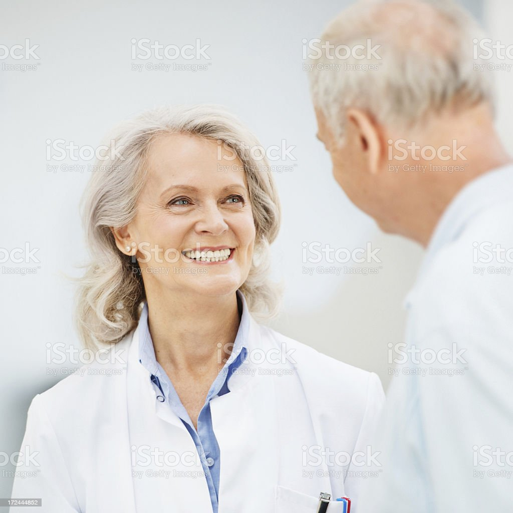 Mature Female Doctor With Senior Patient royalty-free stock photo