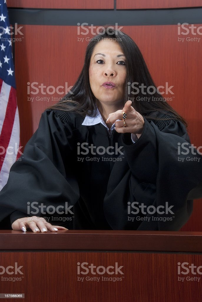Mature female judge pointing a finger at you royalty-free stock photo