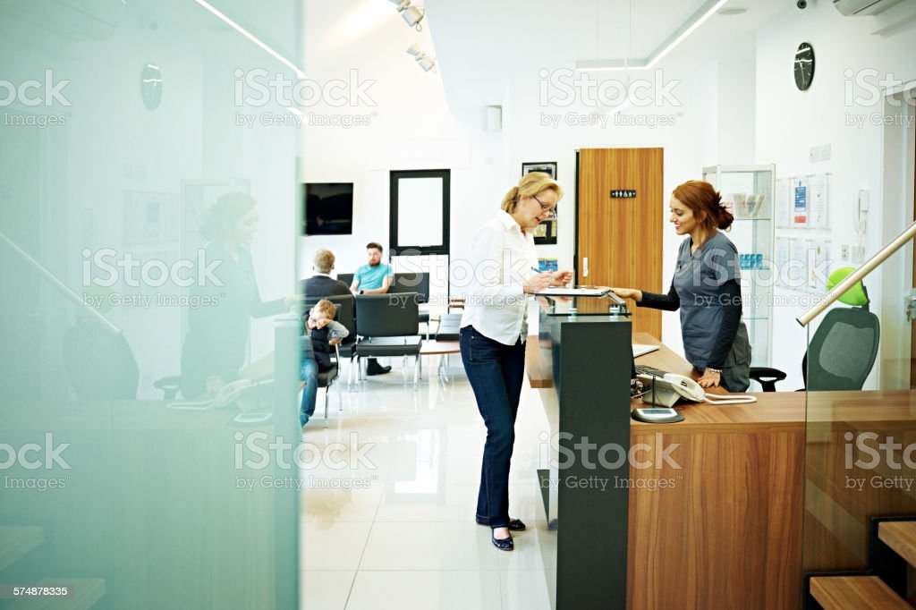 Mature female patient at dental clinic stock photo